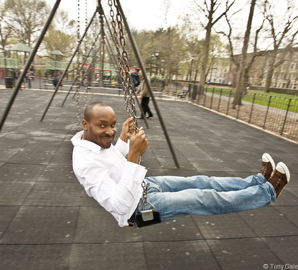 Tai Odunsi, swinging in Prospect Park. © Tony Gale